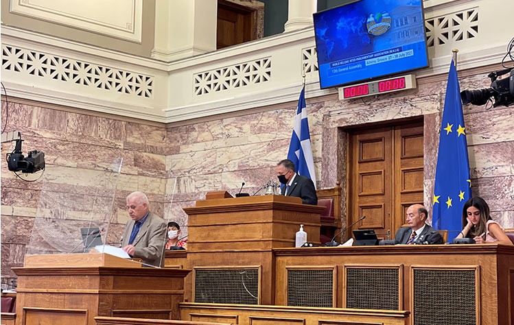 Nomikos speaking at Greek Parliament