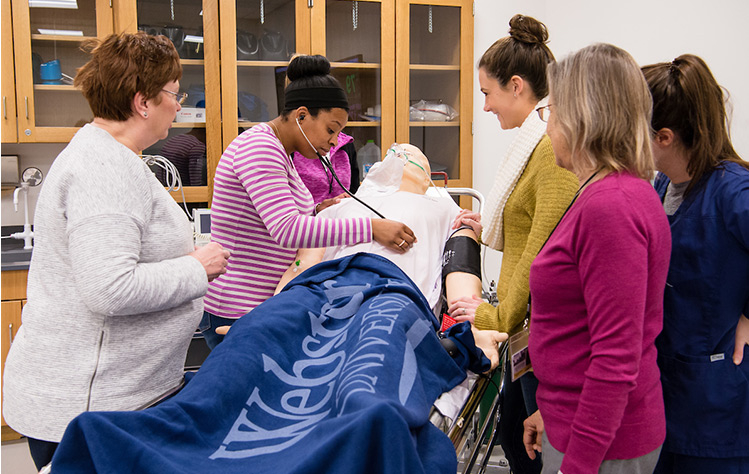 Nursing students in the patient simulator lab