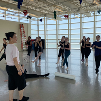 Jie Wang led high school students through a master class.