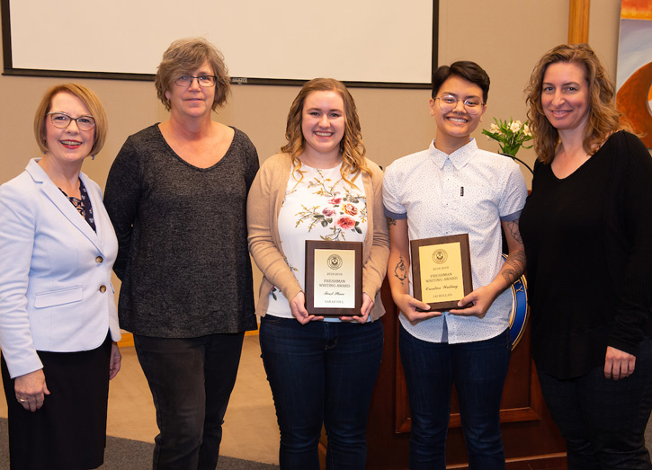 Freshman Writing Award winners with their professors and President Stroble