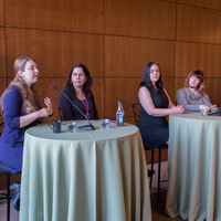 Several panelists discuss the issue of human trafficking during the half-day event, held on March 19, 2016.