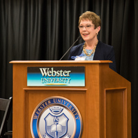 President Elizabeth (Beth) J. Stroble speaks to the attendees at the Stand with Students event held on campus last week. During that symposium, Webster University was lauded as one of five universities that helps students succeed.
