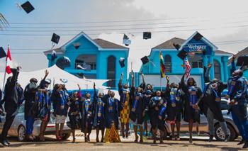 Graduates celebrate at the campus in Accra.