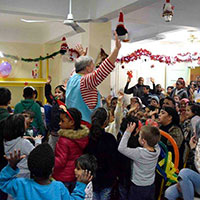 Webster Athens Study Abroad and Local Students Hold Holiday Party for Refugee Children in Athens