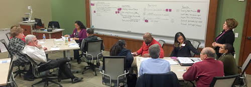 Students in the change management class meet with Rockwood School District