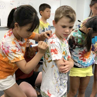 Two Countries, One World: International summer camp brings children from two countries together for a week of fun