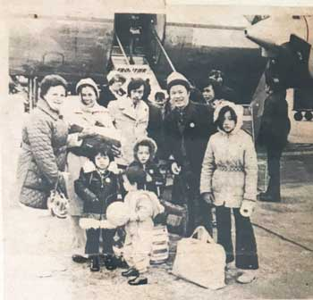 The Dang family on the tarmac at Lambert International Airport in St. Louis. Photo from the St. Louis Post-Dispatch.