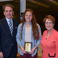 Freshman Writing Award first place winner Anna Grobelny with Provost Schuster and President Stroble