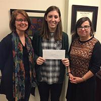 Gina Perhat receiving GAHS scholarship