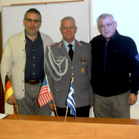 Professor John Nomikos welcomed defense attachés from nine states during the lecture series at Webster Athens.