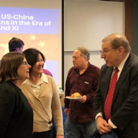 Levine speaks with Nancy Hellerud, vice provost, and Patty Li, Confucius Institute director.
