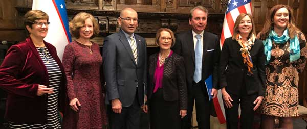Webster officials celebrate with representatives of the Republic of Uzbekistan after signing a new joint agreement to expand educational opportunities in that country.