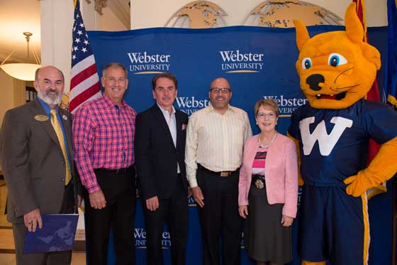 Webster University and Folds of Honor Foundation leaders mark a partnership to benefit military families of those who have been killed or disabled while on active duty.