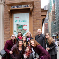 Students and faculty sing at New York City's greatest stage