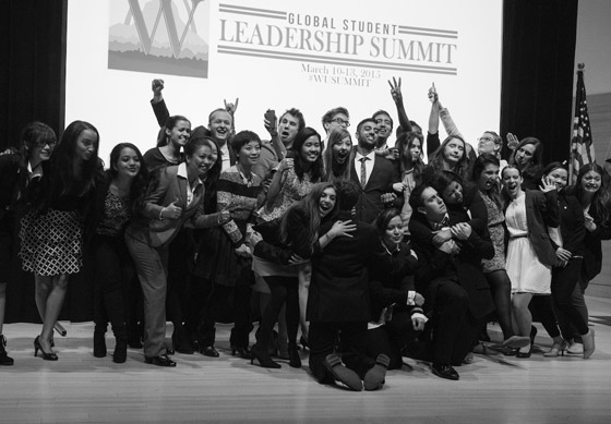 Students celebrate completing their presentations during the 2015 summit