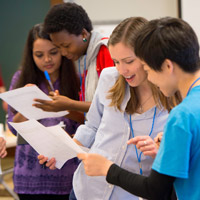 Students share notes at the 2015 summit