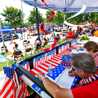 The judges assess the Webster University float in the July 4, 2018 Community Days Parade.